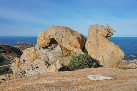 Natural rock formation in the Cap de Creus with the Mediterranean sea in background, El Camell del Pla de Tudela, Spain, Costa Brava, Catalonia
