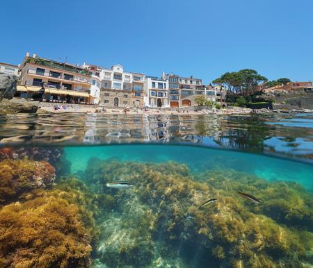 Spain Calella de Palafrugell village, coastline with a cormorant on rock and fish underwater, Costa Brava, Mediterranean sea, Catalonia, split view half over and under water Banque d'images - 117727735