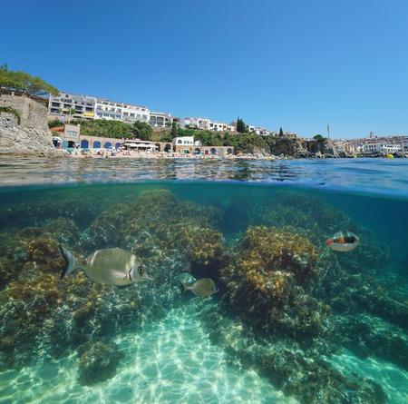 Spain Calella de Palafrugell coastline, split view half over and under water, Costa Brava, Mediterranean sea, Catalonia Banque d'images - 117727736