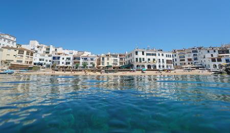 Spain Calella de Palafrugell waterfront Mediterranean village, Catalonia, Costa Brava, En Calau beach, seen from sea surface Banque d'images - 117728031