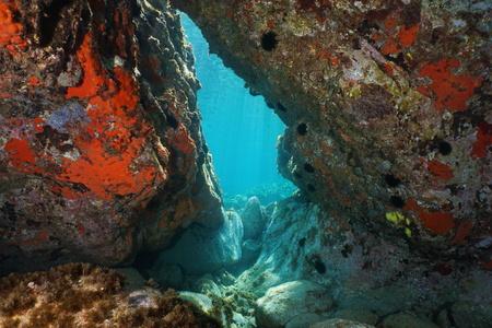 A passage below rocks underwater in the Mediterranean sea, natural scene, Italy Imagens