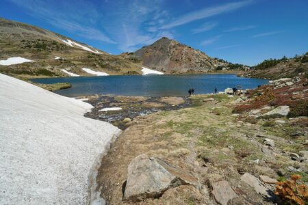 France Pyrenees mountain Casteilla lake with fishermen, landscape in the natural park of the Catalan Pyrenees Reklamní fotografie
