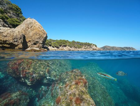 Wild rocky coast in Spain on the Costa Brava, Mediterranean sea, split view over and under water surface, Roses, Cap de Creus, Catalonia
