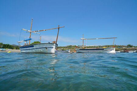 Spain typical Mediterranean boats anchored near sea shore, Portlligat, Cadaques, Costa Brava, Catalonia Reklamní fotografie