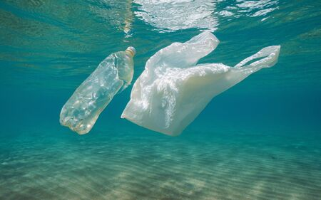 Underwater pollution, plastic bag and bottle in the sea, Mediterranean, France