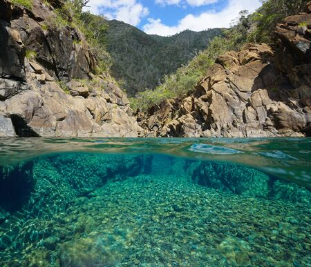 Rocky river with clear water, split view over and under water surface, Oceania, New Caledonia, Dumbea Archivio Fotografico