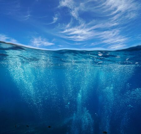 Seascape, air bubbles underwater sea and blue sky with cloud, split view over and under water surface, Mediterranean, France Reklamní fotografie