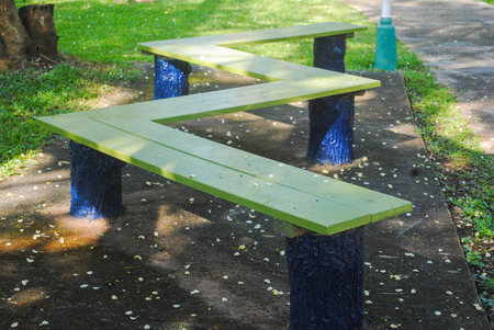 insists: Long Green bench in the park