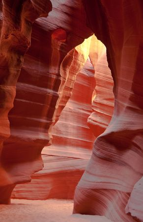 Red stone bear looking at the moon in Antelope Canyon photo