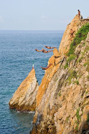 Group of cliff divers in free fly photo