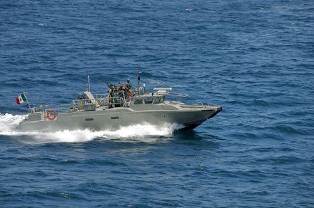 Mexican coastal guard speed boat escorting ship