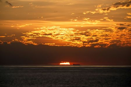 Ships silhouette on the horizon against the background of the setting sun Stock Photo - 6545128