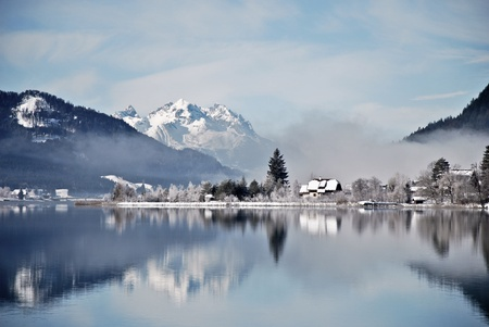 Lake Weissensee in Austrian Alps in winter with scenic reflection photo