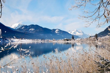 Lake Weissensee in Austrian Alps in winter with scenic reflection