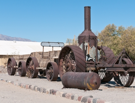 old tractors: Steam tractor and ore wagons used at old borax mine in Death Valley