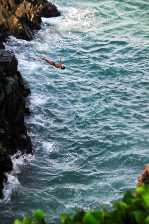 Cliff diver in the free fly
