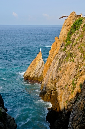 Cliff diver in the free fly photo