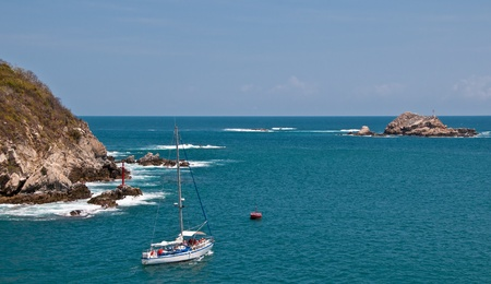 Yacht with tourists near Mexican pacific coast of Huatulco Stock Photo