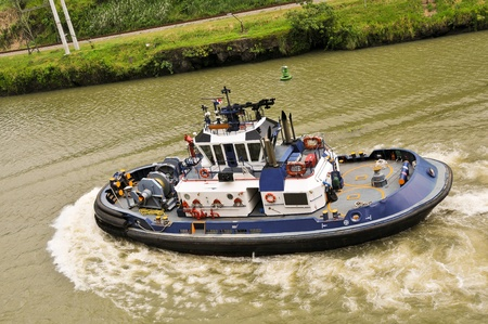 maneuvering: Tugboat accompanies ship in the Panama Channel