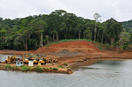 strengthening: Vehicles strengthening the banks of the Panama Canal
