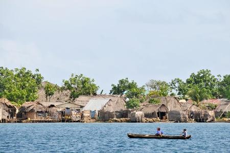 Kuna indian children sailing along the vilage on San Blas island