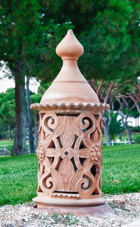 Clay lamp along the walkway in the garden
