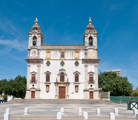 Church in Faro, Portugal, with two bell towers and a clock