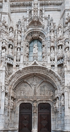 Facade with entrance doors of the old cathedral in Lisbon, Portugal
