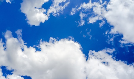 White clouds in the blue sky in early spring Stock Photo
