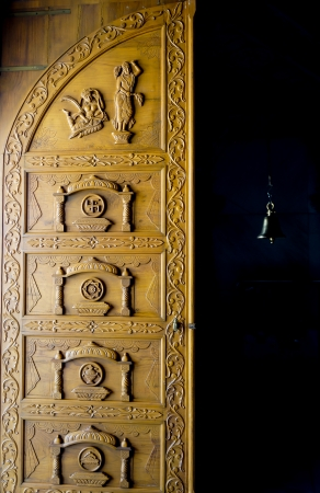 Wooden door of Jain temple in India with traditional ornament and symbols Stock Photo