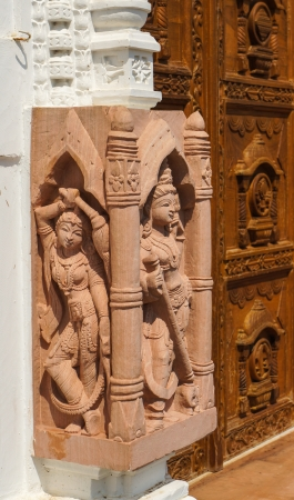 Carving sculptures at the entrance to Jain temple in India