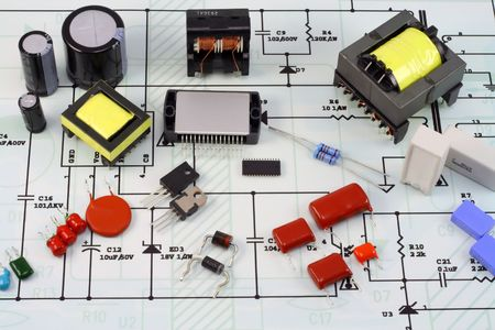Electronic components and spare parts - resistors, capacitors, diodes, transformers, transistors, microcircuits and so on. Elements are located on the electric scheme. photo
