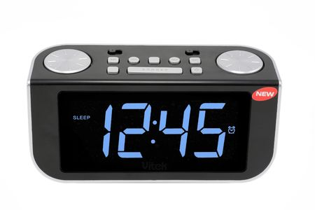 Modern compact digital electronic clock from radio. It is isolated on the white. MAss production.