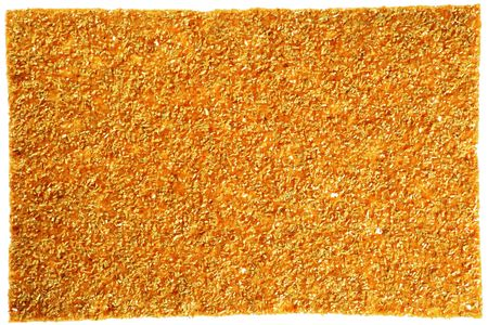 The flat roasted crispbread with salt grains. Isolated on white.