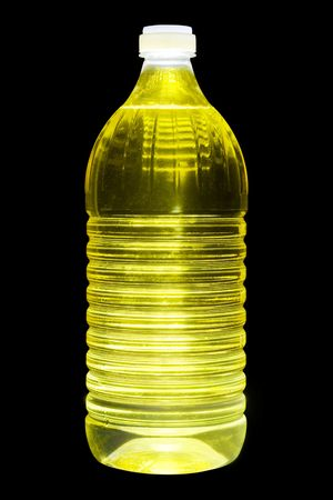 sunflowerseed: Plastic one litre bottle with pure sunflower-seed oil. A luminescence from within. Isolated on the black. Stock Photo