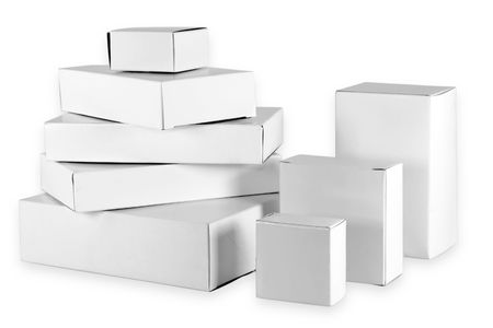 Set of small white  cardboard boxes of the different size.  photo