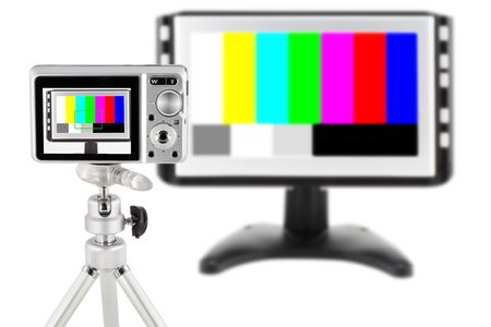 The mass compact digital camera test. The target is the modern TV with the color test sheet. Isolated on white. photo