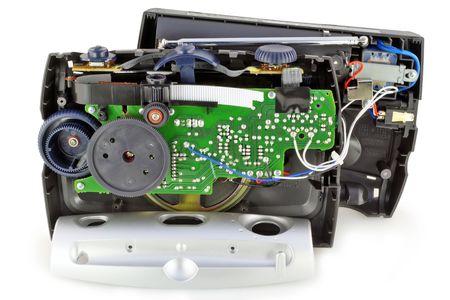 disassembled: Cracked disassembled broken analog radio device. Isolated on white. Stock Photo