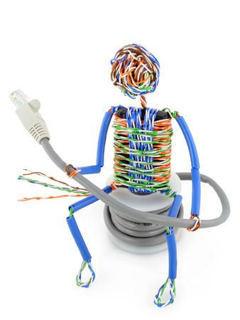 network cable: The stylised little man made of a computer cable sits on spool UTP and looks on connector. Isolated on white. Stock Photo