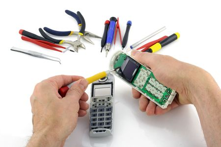The technician repairs a modern telephone. Isolated on white. Stock Photo - 7577179