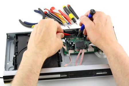 The technician repairs a DVD Player. Isolated on white. Stock Photo - 7577189