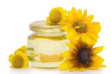 curative: Cosmetic curative oil from yellow flowers. Isolated on white.