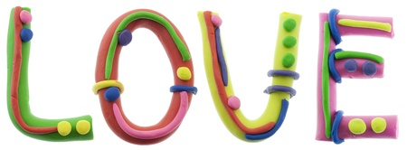 Real cheerful plastic plasticine alphabet- L, O, V, E letters, LOVE word. Isolated on white photo