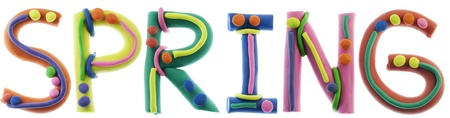 g p: Real cheerful plastic plasticine alphabet- S, P, R, I, N, G  letters, SPRING word. Isolated on white Stock Photo
