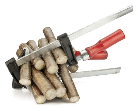 clamped: Wooden logs are clamped in clamps.  Pain, stress, pressure concept