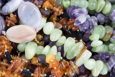 pietre preziose: Amber, malachite, turchese, disgrazie, pietre semipreziose sfondo macro texture Archivio Fotografico