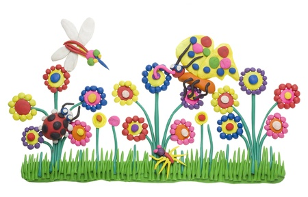 Plastic clay plasticine children handmade collage - insects life and meadow. Isolated photo