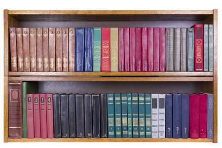 Old retro books with color covers on a wooden shelf  front view. Mass production. Isolated with patch