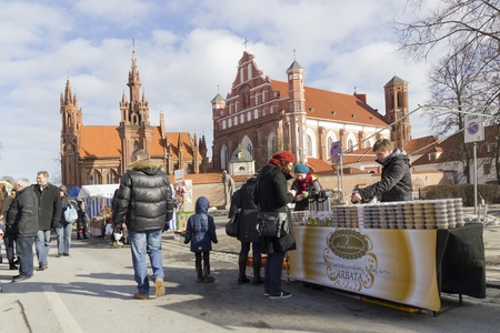 vilnius: VILNIUS- MARCH 4: Fair devoted to the beginning of spring on March, 4th 2012 in Vilnius, Lithuania. Sale of homemade products,  on the background is the church of St. Anne Editorial