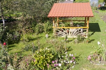path cottage garden: Wooden summer pavilion for  barbecue in the  european garden